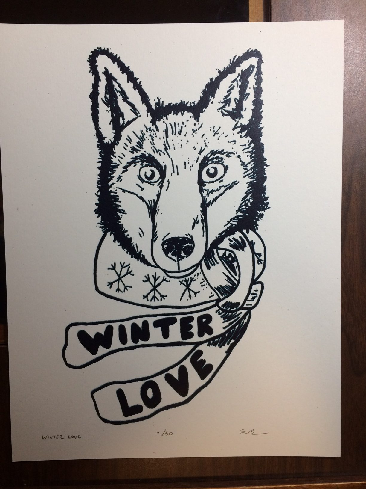 Fox wearing a scarf that says winter love