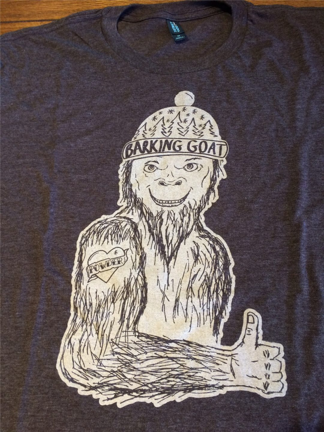 Heathered T-shirts with a Sasquatch print with a powder tattoo.
