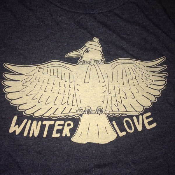 Crow holding a ski wearing a beanie and a scarf. Winter Love is printed below the crow.