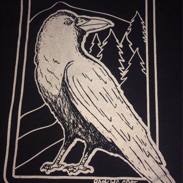 A crow standing in front of a mountain scene that say Idaho Love.