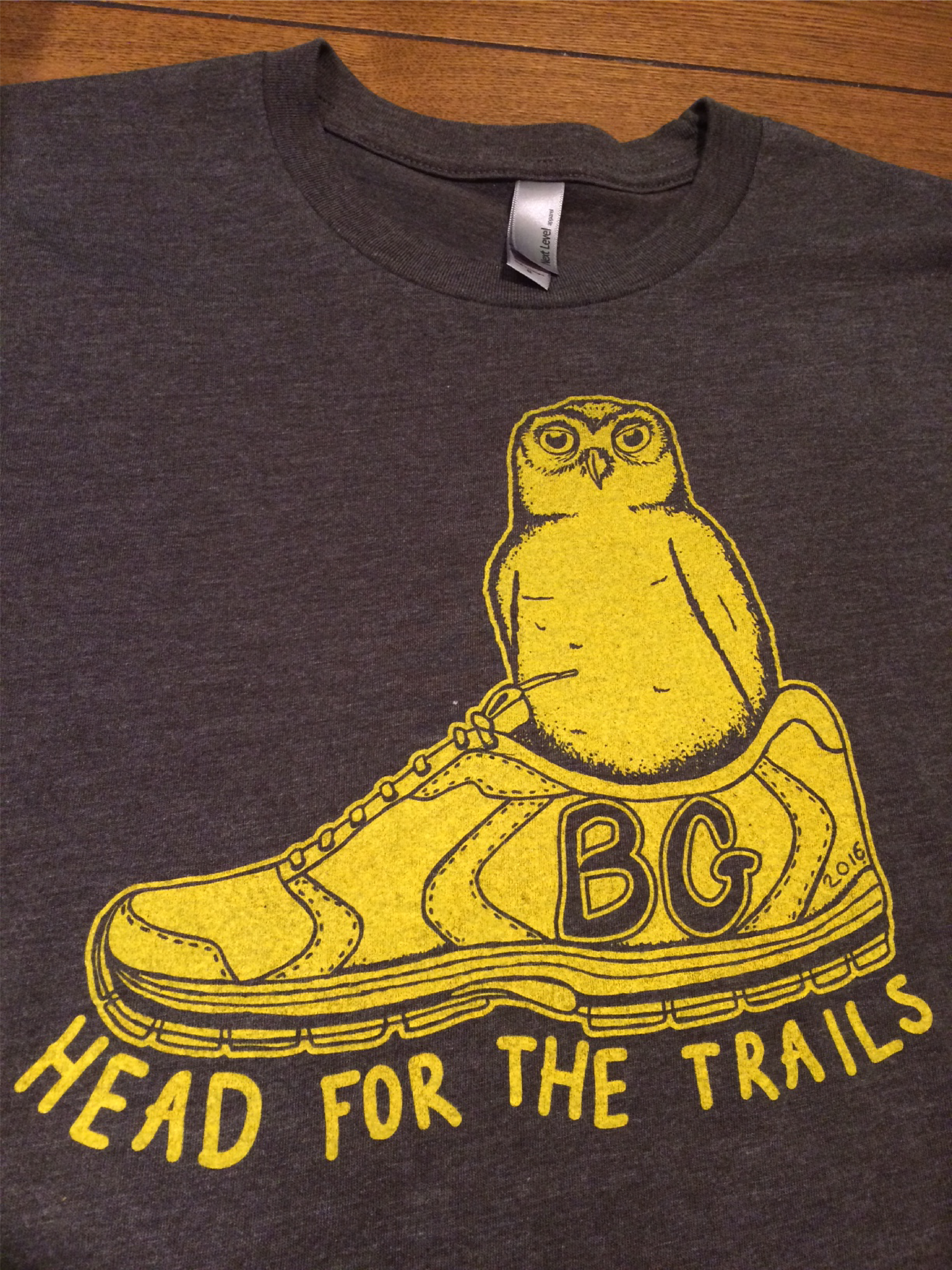 Small Owl inside a running shoe that says Head for the Trails.