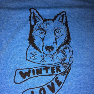 Fox Wearing a scaf that says Winter Love.