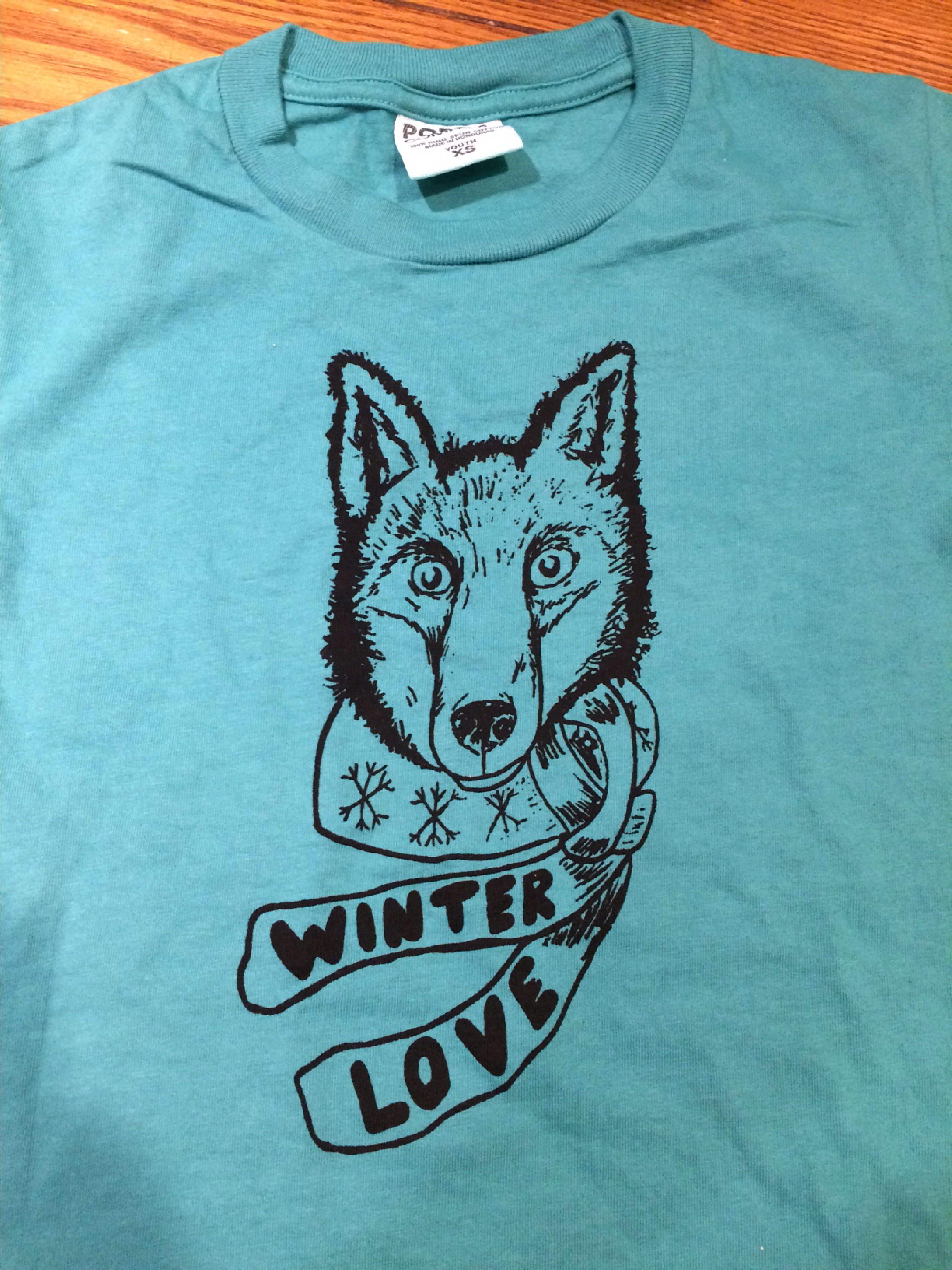 Fox Wearing a scarf that says Winter Love.